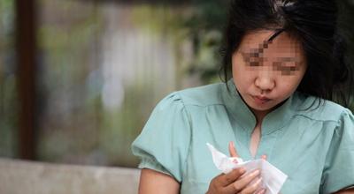郑州街头流浪女是海归 在北京一电视台工作过