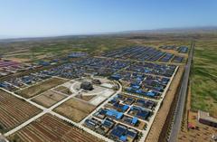甘肃祁连山区4万居民走出大山戈壁沙海建新城