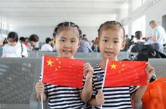 福建三明开展奥运助威活动 旅客纷纷送祝福