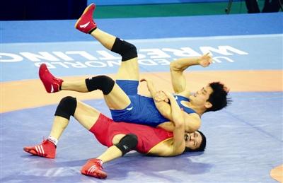摔跤名将别克1分02秒夺冠  第十三届全运会甘肃团再添一金