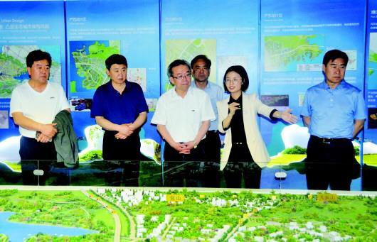 吴仰东率酒泉市党政考察团在武汉市考察学习并洽谈合作事宜(图)
