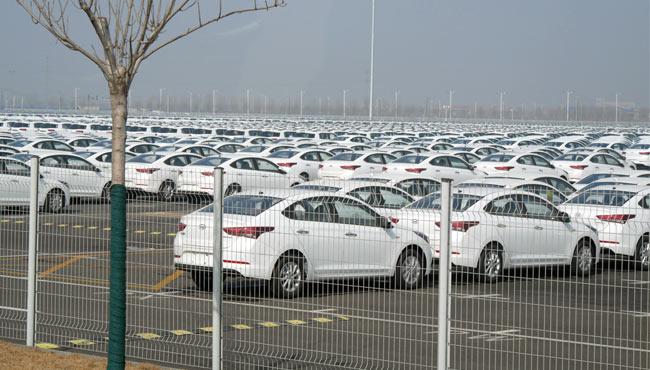 """车市""""寒冬"""" 暖意犹存 新能源车产销两旺 传统汽车库存优化"""