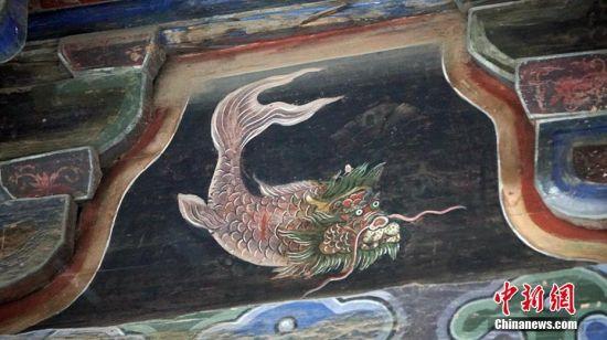 """图为《山海经》神兽图。有专家称""""龙头鱼"""",目前尚未定论。魏建军 摄"""